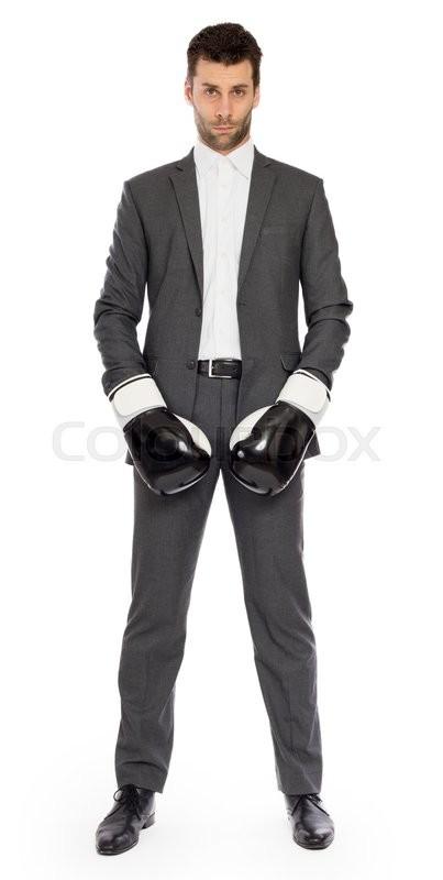 Stock image of 'Businessman in boxing gloves isolated on white'