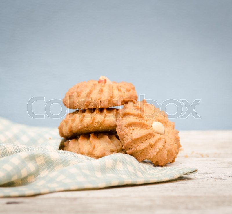 Stock image of 'Nut cookies on table,vintage background'