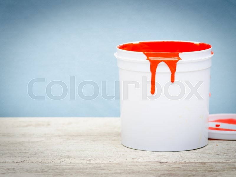 Stock image of 'White plastic bucket with red color paint on wood,vintage background'