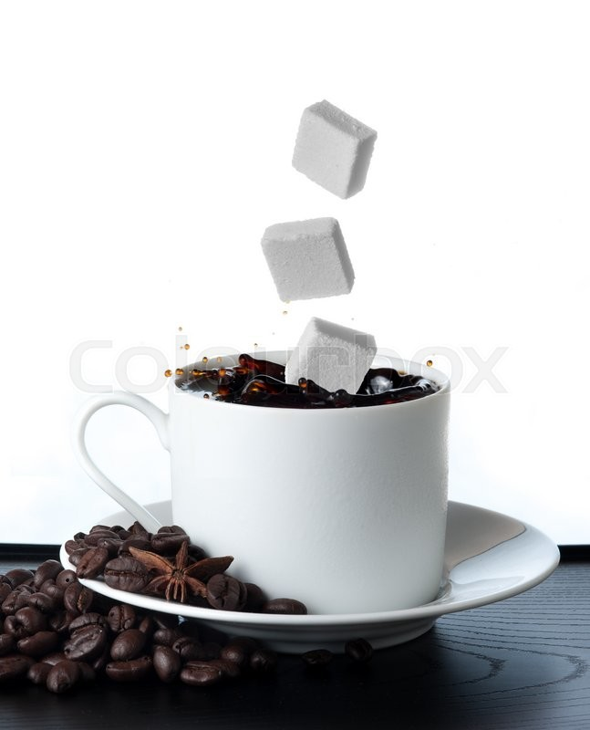 Stock image of 'Cup of coffee with falling sugar cube  isolated on white background'