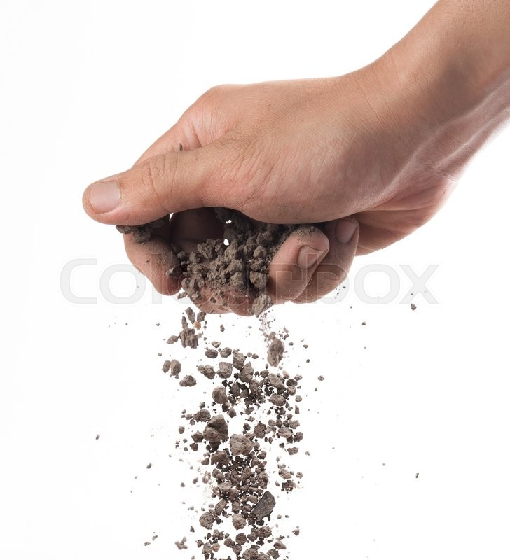 Stock image of 'Hand sprinkling soil on white background'