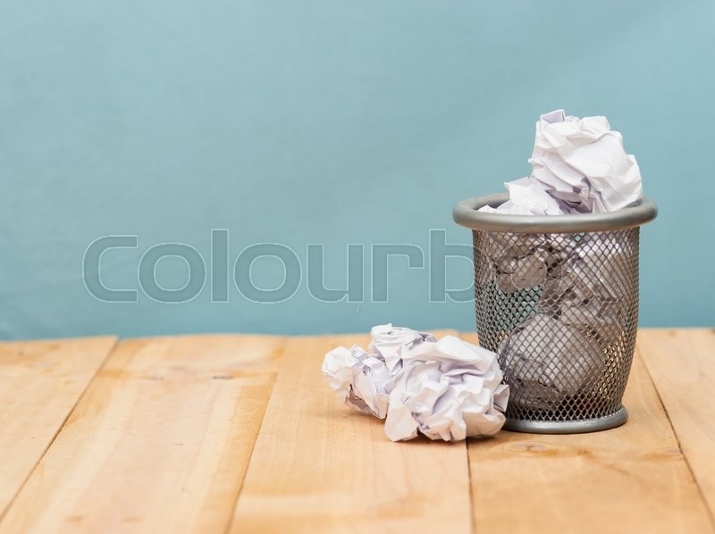Stock image of 'Recycle,trash bin and crumpled paper balls on wood ; vintage tone style'