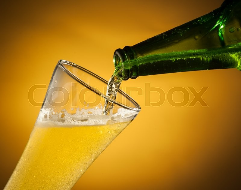Stock image of 'Pouring beer into glass'