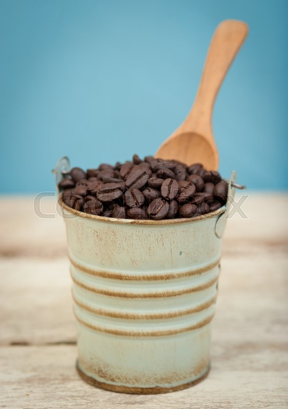 Stock image of 'Coffee beans in small tank on wood,vintage tone style,Selective focus'