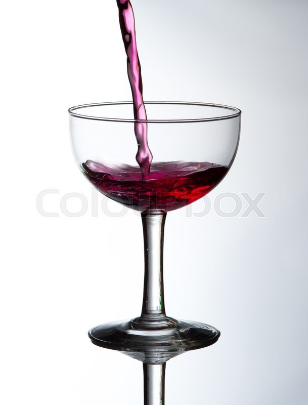 Stock image of 'Red wine pouring'