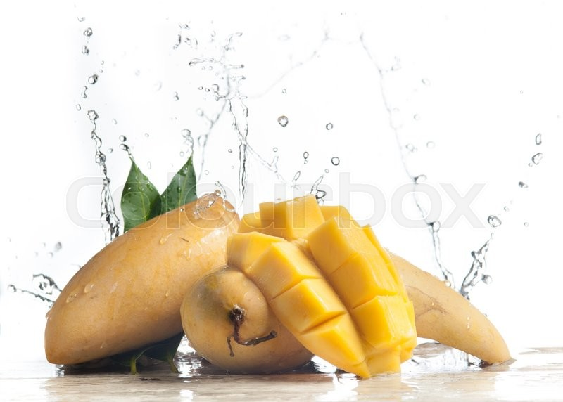 Stock image of 'Mango splashing over clear water on white background'