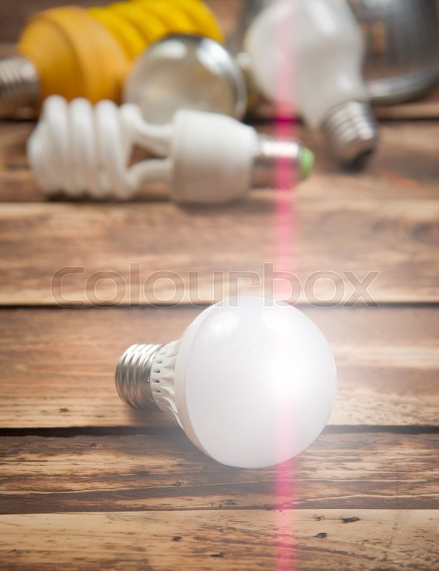 Stock image of 'LED bulb and Incandescent bulbs on the wooden,Light Effect'