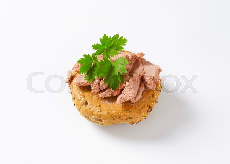 Stock image of 'fresh bulkie roll with pate'