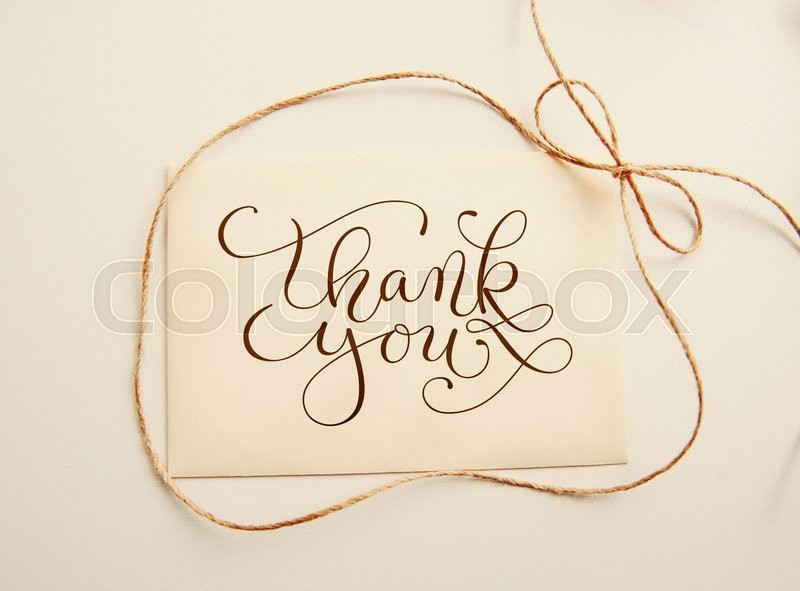 Stock image of 'Sheet of paper with bow  and text thank you. Greating card'