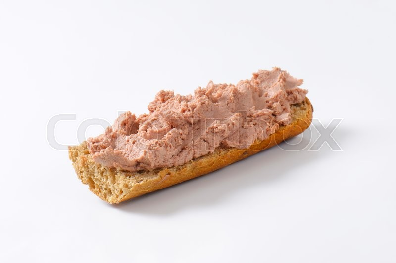 Stock image of 'Baguette roll with pate on white background'