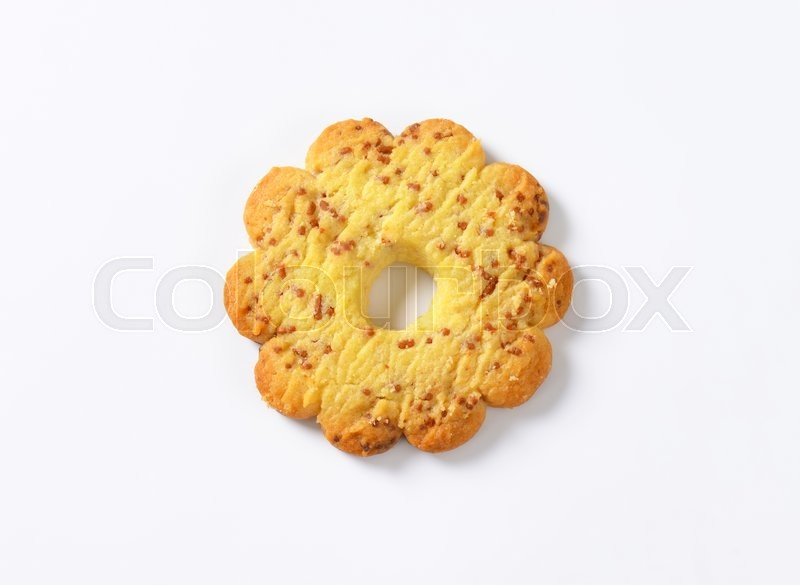 Stock image of 'Italian flower-shaped vanilla biscuit with bits of chocolate'