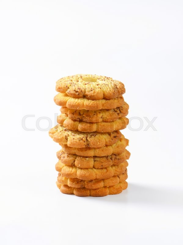 Stock image of 'Italian flower-shaped vanilla cookies with bits of chocolate'