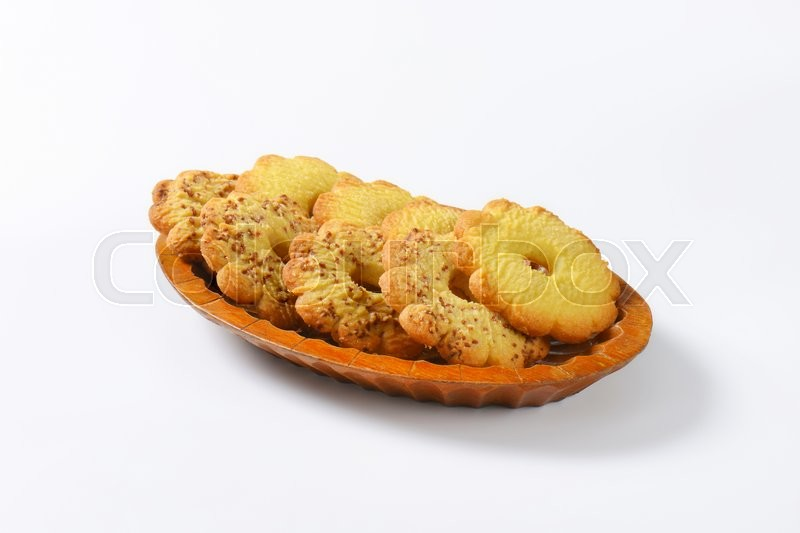 Stock image of 'Bowl of Canestrelli biscuits (Italian flower-shaped vanilla cookies)'
