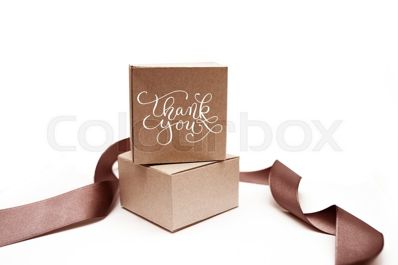 Stock image of 'Gift boxes with brown ribbon on a white background  and text thank you.'