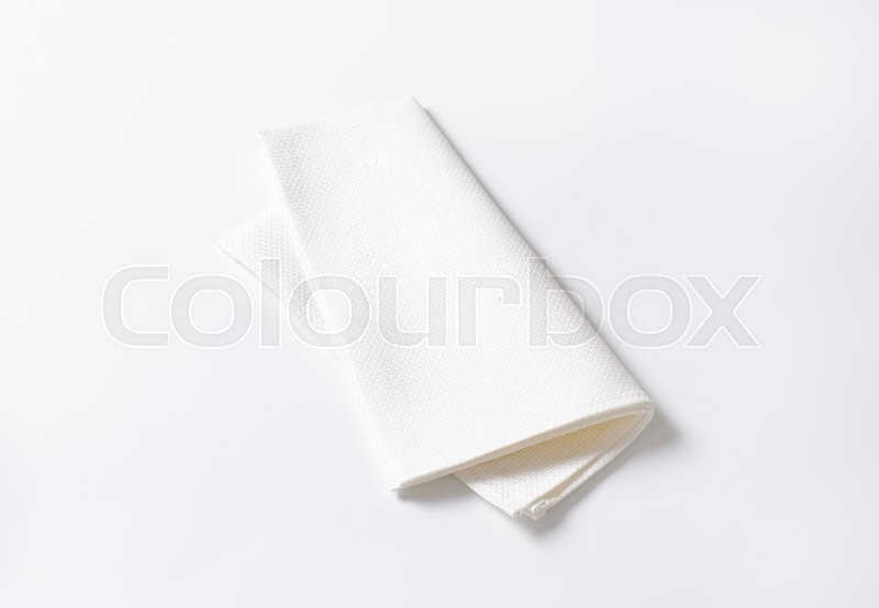 Stock image of 'Single clean white fabric napkin'