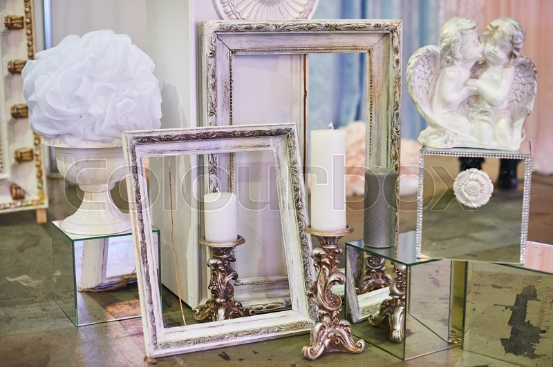 Stock image of 'old photo frames and candles with decorations for photo studio.'
