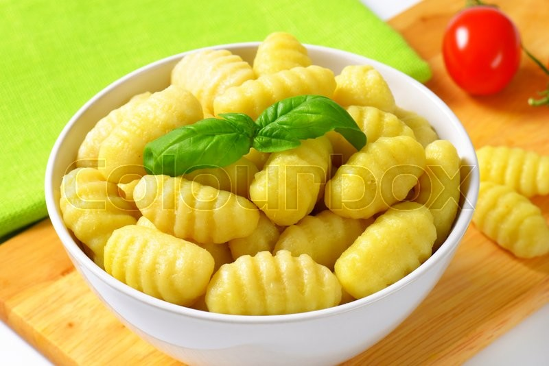 Stock image of 'Bowl of cooked potato gnocchi'