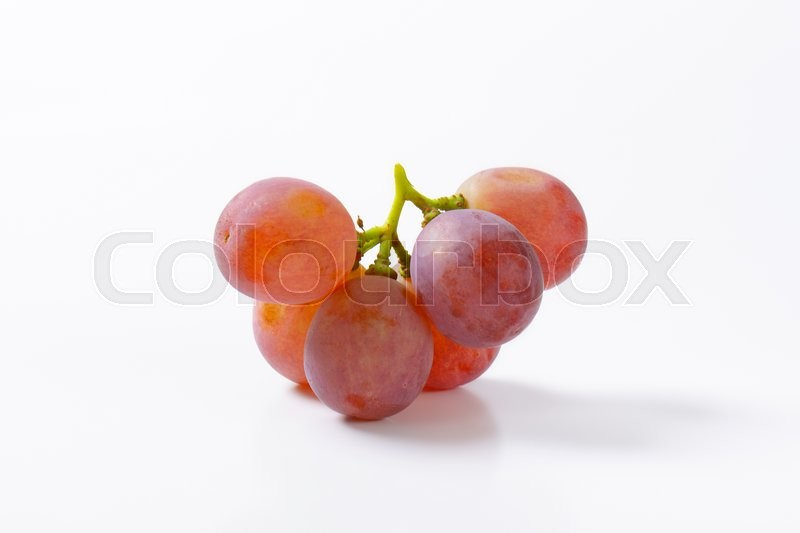 Stock image of 'Fresh seedless red table grapes'