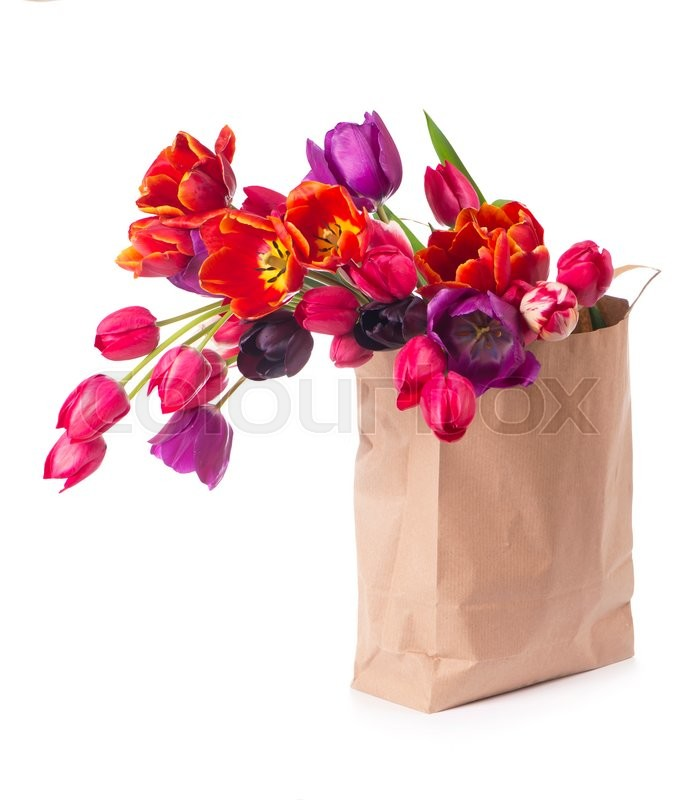 Stock image of 'Paper shopping bag with colorful tulips in spring'