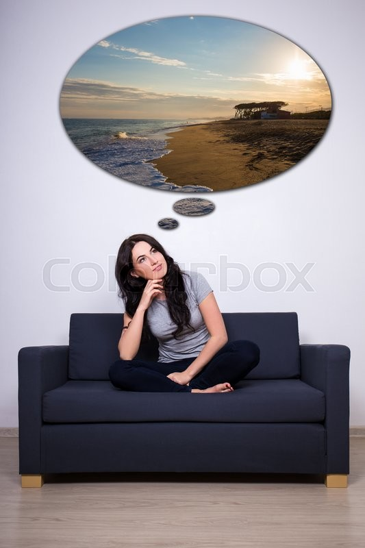 Stock image of 'young happy woman sitting on sofa and thinking or dreaming about vacation'