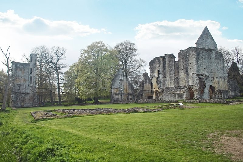 Stock image of 'The picturesque ruins of Minster Lovell Hall, are a 15th century manor house, lie in a beautiful rural setting beside the River Windrush in Oxfordshire England.'