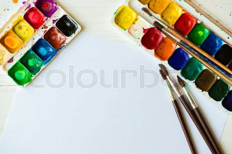 Stock image of 'Art of Painting. Painting set: brushes, paints, crayons, watercolor, acrylic paint on a white wooden background'