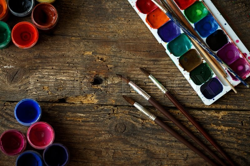 Stock image of 'Art of Painting. Painting set: brushes, paints, crayons, watercolor, acrylic paint on a wooden background'