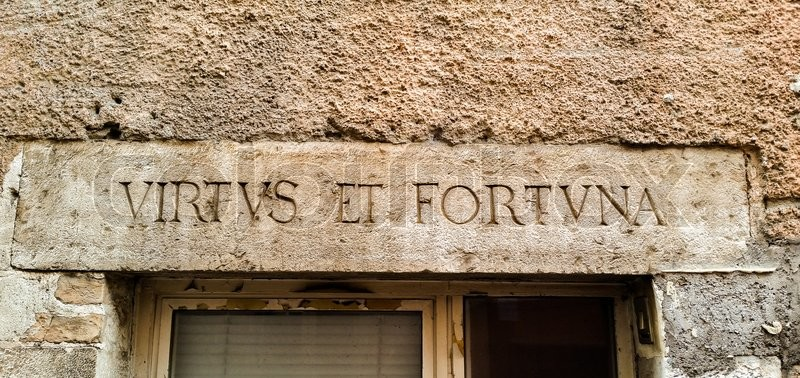 Stock image of 'on the wall of a village near Rome, there is a Latin inscription on the wall'
