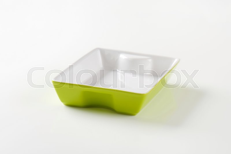 Stock image of 'Rectangle ceramic baking dish - white on the inside, green on the outside'