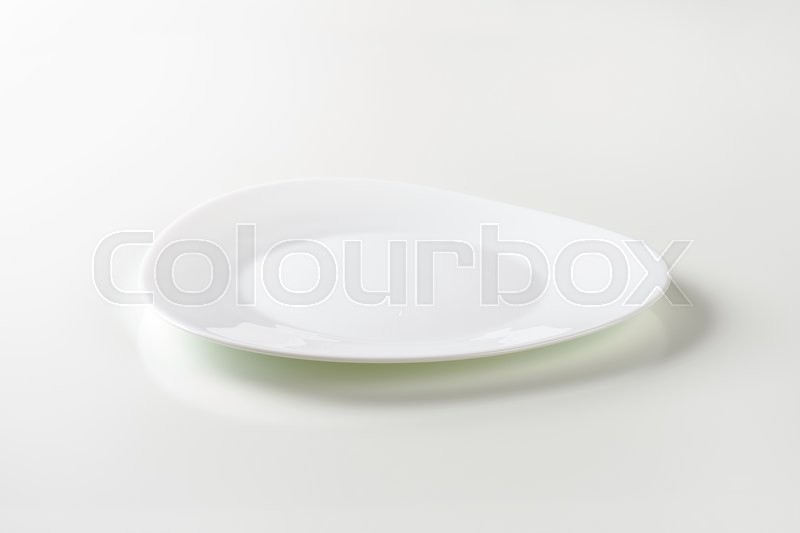 Stock image of 'Triangle white plate with rounded edges and wide rim'
