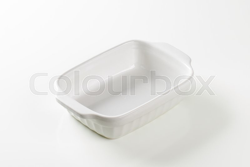 Stock image of 'Classic white ceramic casserole dish with handles'