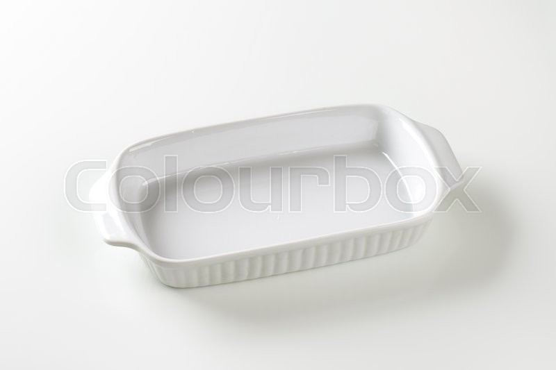 Stock image of 'Classic white ceramic baking dish with handles'