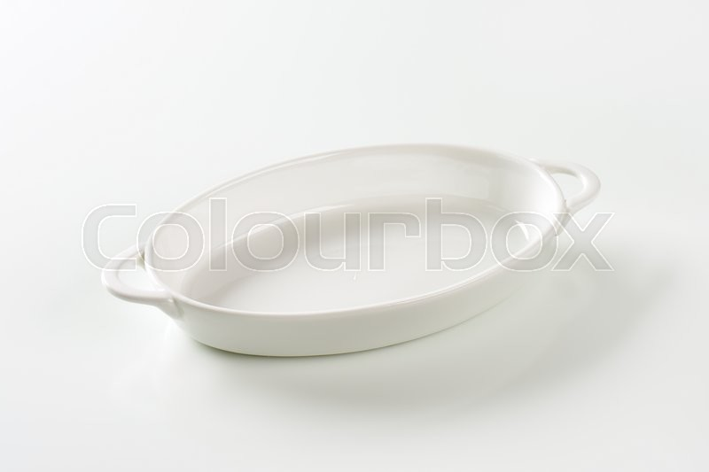 Stock image of 'Oval white ceramic dish with handles'