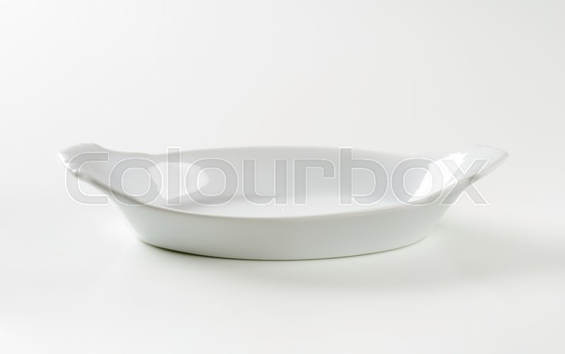 Stock image of 'Oval White Ceramic Baking Dish ideal for making and serving gratin'