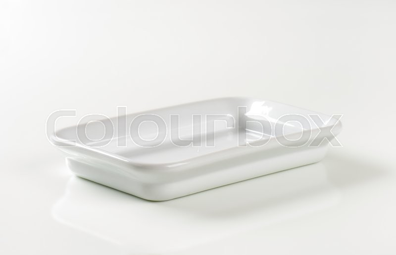 Stock image of 'Rectangle ceramic cook and serve dish'