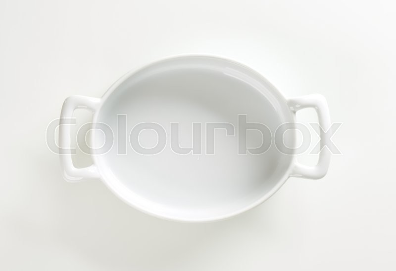 Stock image of 'Deep oval baking dish with two handles'