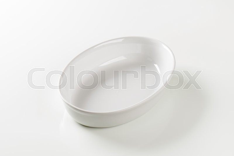 Stock image of 'Empty deep oval porcelain dish'