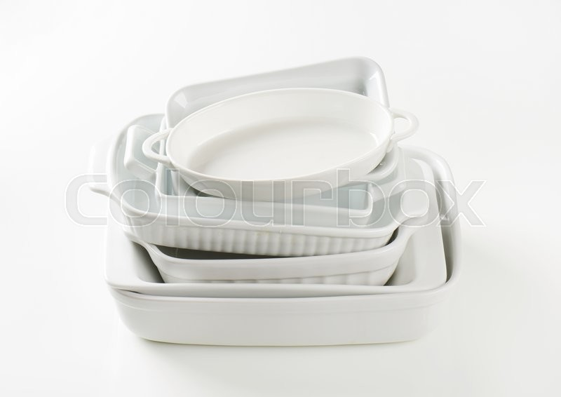 Stock image of 'Stacked baking dishes of various sizes and shapes'
