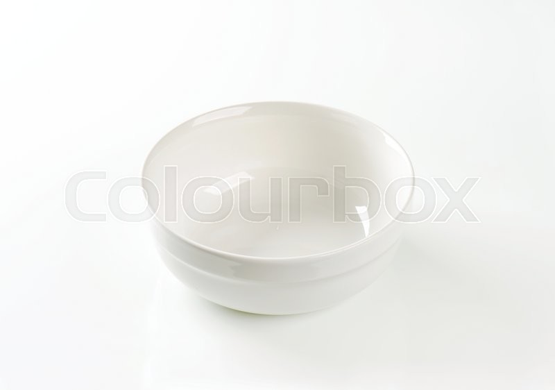 Stock image of 'Empty round white serving bowl'