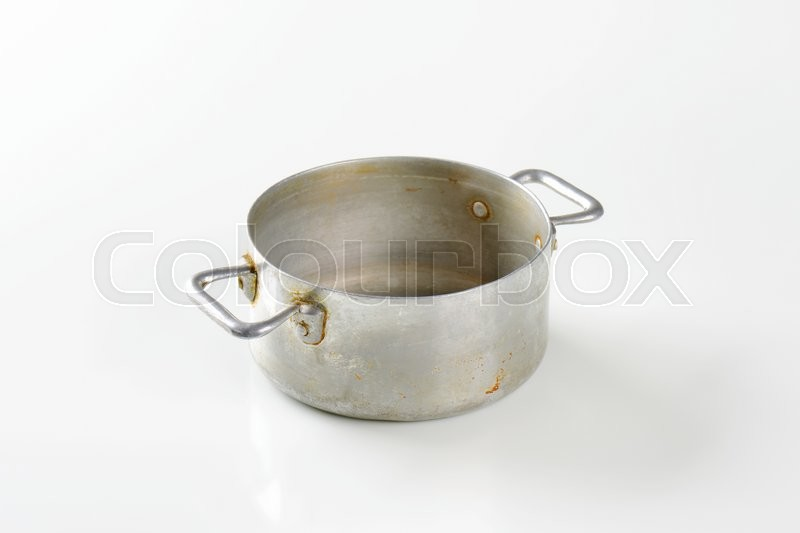 Stock image of 'Old rusty aluminum sauce pot'