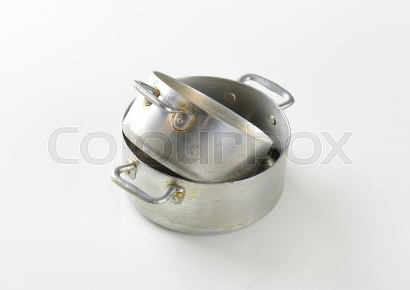 Stock image of 'Two rusty aluminum sauce pots'