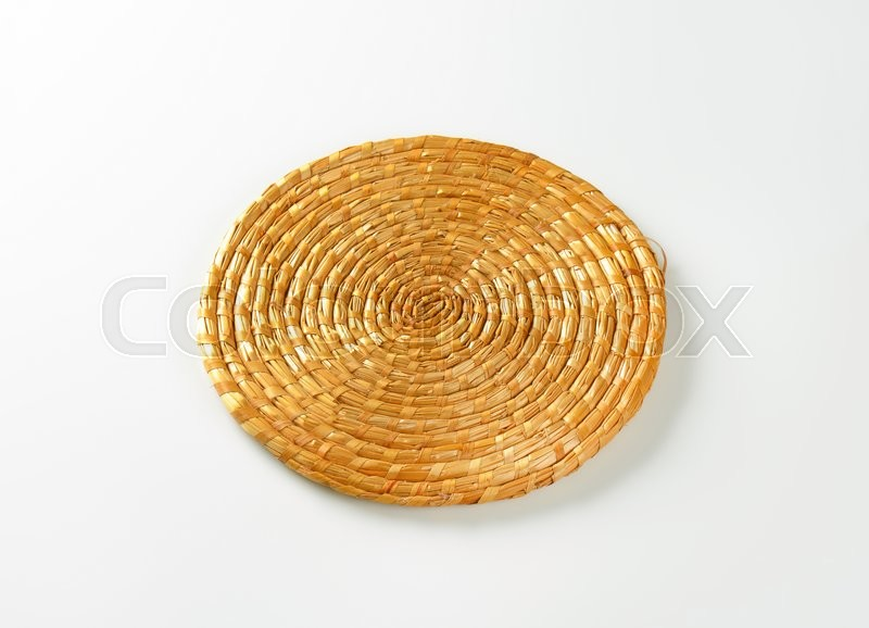 Stock image of 'Single round straw place mat'