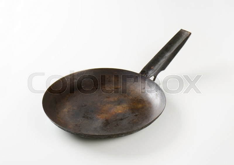 Stock image of 'Rusty black skillet with one handle'