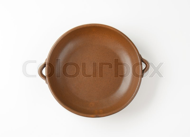 Stock image of 'Empty round brown baking dish'