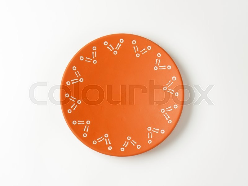 Stock image of 'Single decorative terracotta dinner plate'