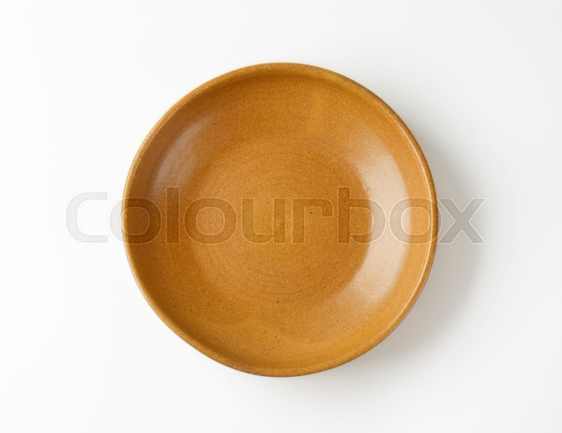 Stock image of 'Empty brown ceramic serving bowl'