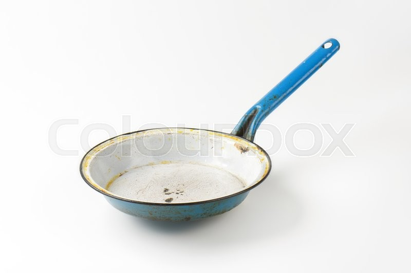 Stock image of 'Empty old rusty frying pan'
