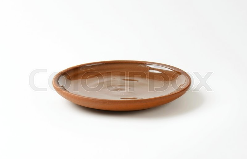 Stock image of 'Round brown ceramic dinner plate'