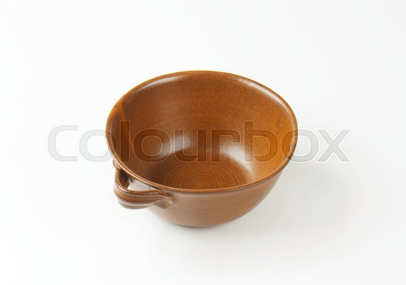 Stock image of 'Deep round brown pottery dish'