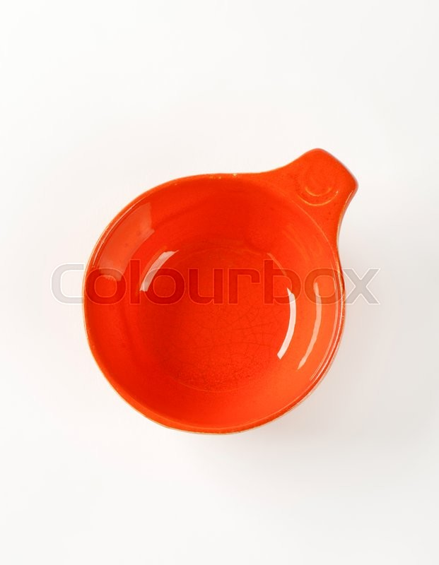 Stock image of 'Red glazed ceramic cup or soup bowl'